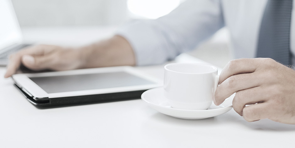 Businessman with coffee and tablet